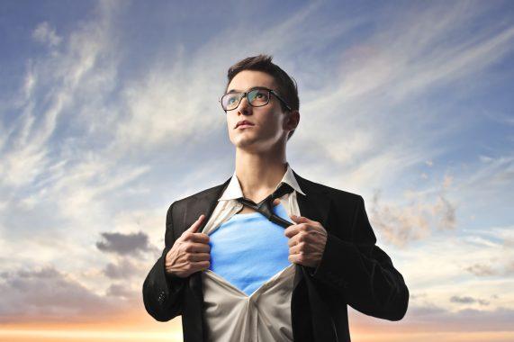 Businessman rips open shirt to reveal superhero costume underneath