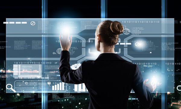 Woman examining vertical digital screen